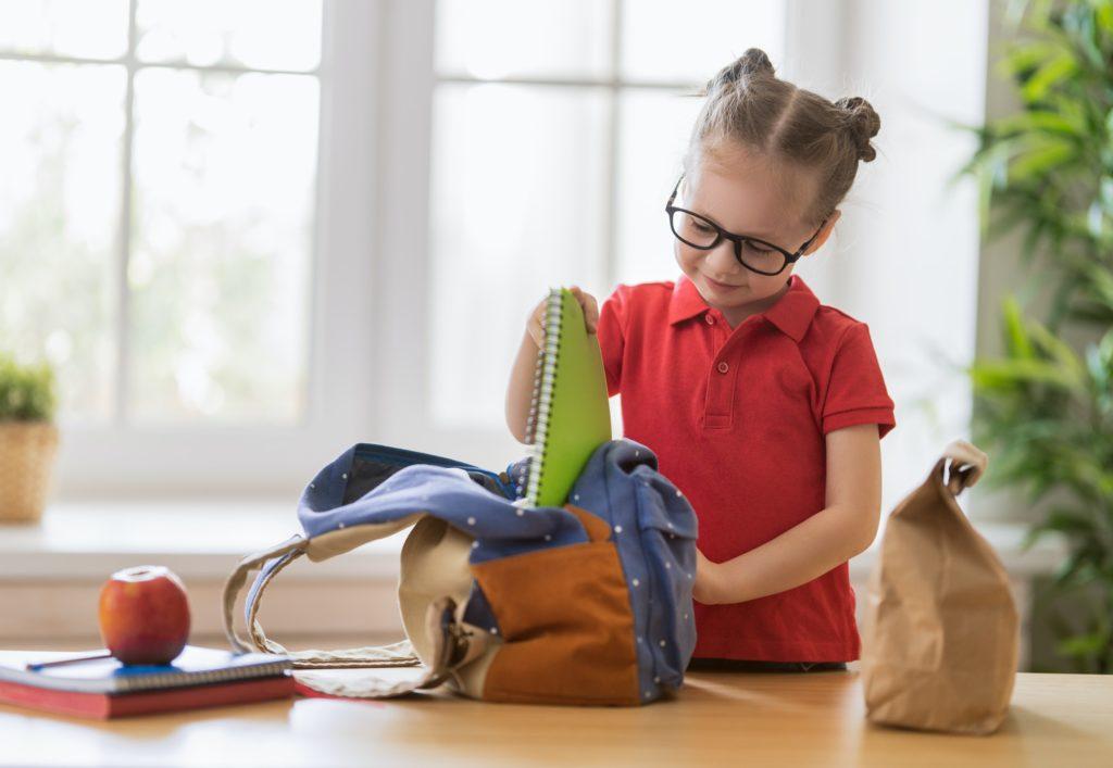 child preparing for school